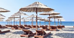 sunbeds and parasols on the beach